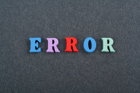 ERROR word on black board background composed from colorful abc alphabet block wooden letters, copy space for ad text. Learning english concept.