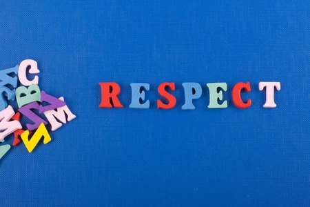 RESPECT word on blue background composed from colorful abc alphabet block wooden letters, copy space for ad text. Learning english concept.