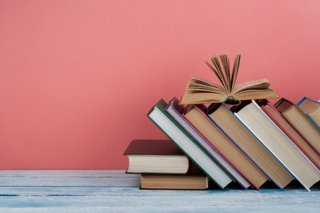 Stack of colorful books. Education background. Back to school. Book, hardback colorful books on wooden table. Education business concept. Copy space for text.