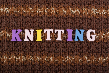 messy clothes: Knitting. Knitted Fabric Texture. Word composed from ABC alphabet letters.