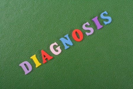 DIAGNOSIS word on green background composed from colorful abc alphabet block wooden letters, copy space for ad text. Learning english concept.