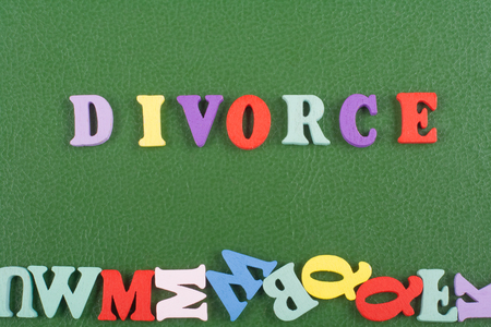 loveless: DIVORCE word on green background composed from colorful abc alphabet block wooden letters, copy space for ad text. Learning english concept.