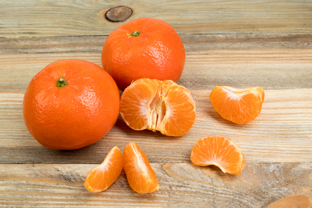 Ripe orange fresh mandarin , clean mandarin, mandarin slices, on wooden background. Stock Photo