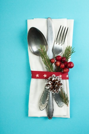 Christmas table place setting. Holidays background. Top view with copy space. Stock Photo