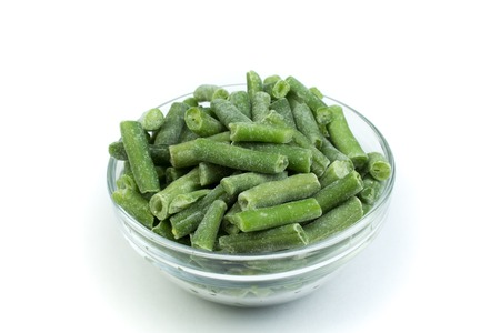 Bowl of green beans isolated on white background, top view.