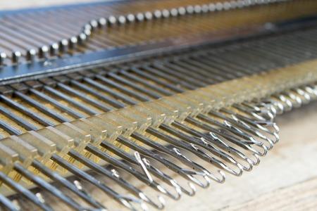 knitting machine for knitting at home. hooks, close-up. Standard-Bild - 122990668