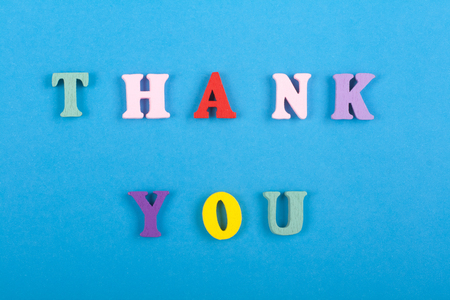 THANK YOU word on blue background composed from colorful abc alphabet block wooden letters, copy space for ad text. Learning english concept.