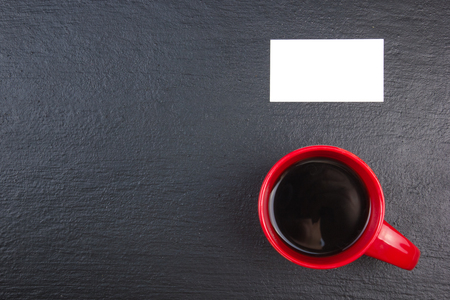 Blank business cards,cup of coffee on the wooden table. Template for ID. Top view. blackboard Stock Photo