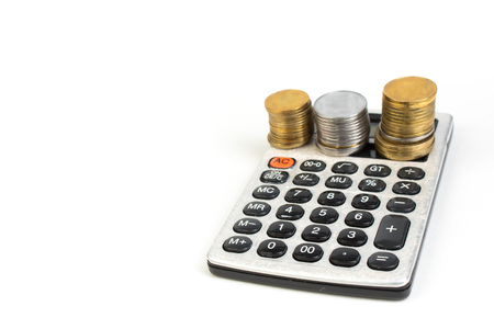 Money, Financial, Business Growth concept, Stack of coins and calculator on white background Imagens