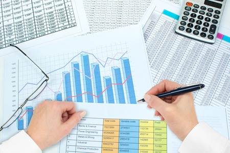 Financial Charts, graphs, coins, calculator on isolated white background.