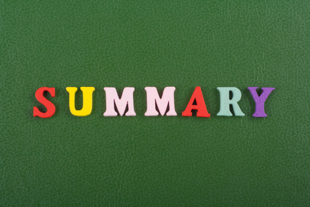 SUMMARY word on green background composed from colorful abc alphabet block wooden letters, copy space for ad text. Learning english concept.