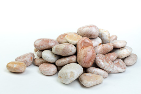 Small sea stones, isolated on white. with copy space Banco de Imagens