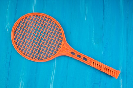 Tennis rackets on blue wooden background. Top view.