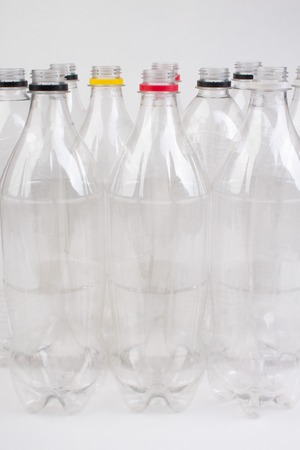 collection of empty used plastic bottles on white background. Imagens - 124676484