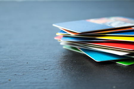 Stack of bank cards on a black background.