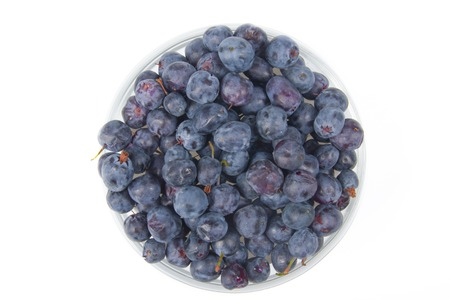 Blueberry on wooden table background, bowl of blueberries. Antioxidants, detox diet, organic fruits. Top view. Berries