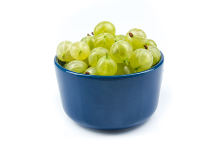 Fresh gooseberries on plate on Isolated white background. Berries