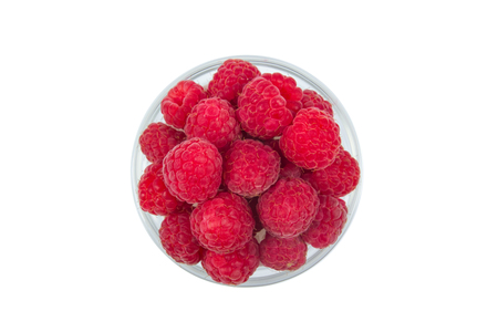 Fresh raspberries, on plate on Isolated white background. Berries