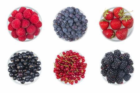 Berries on Isolated white background, bowl of Cherry, currant, blueberries, gooseberries, raspberries, blackberries, strawberries. Stockfoto
