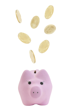 Golden coins falling into a pink piggy bank, isolated on white background.