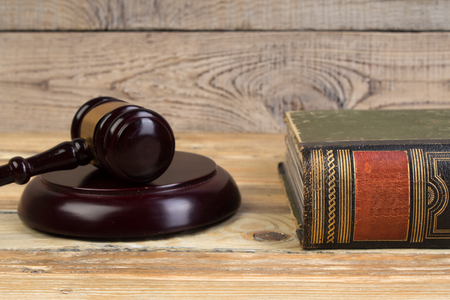 Judge gavel on the book on wooden table. justice and law concept.