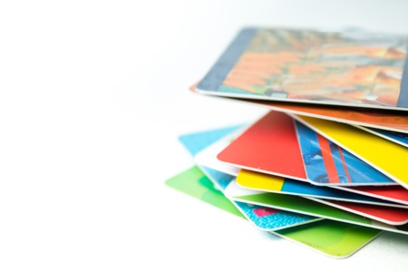 Stack of bank cards on a white background. Banco de Imagens