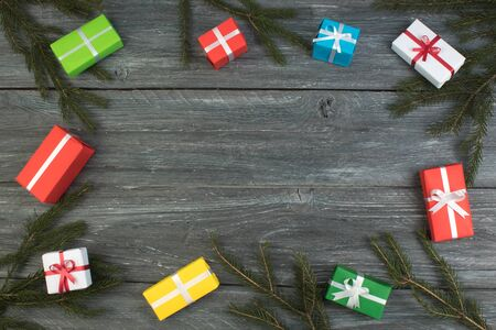 Gift boxes and colorful present for christmas on wood table. Top view with copy space. Imagens