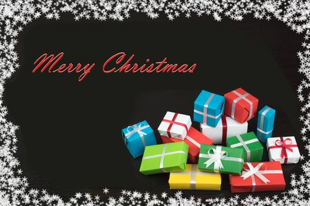 Gift boxes and colorful present for christmas on blackboard. Top view with copy space. Imagens