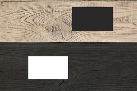 Blank business cards on the wooden table. Template for ID. Top view.