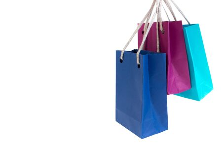 Paper shopping bags with handles on white background. Mockup for design. black friday, sale Imagens