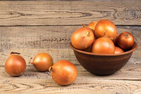 onion in a plate on wooden background.