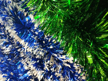 Colorful tinsel , Christmas decorations holiday background