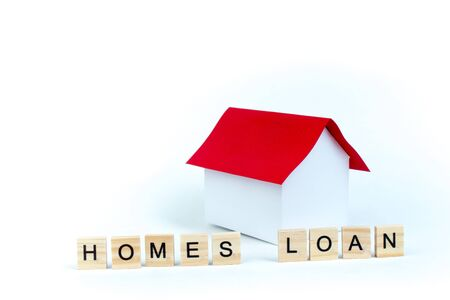 Home loans- word composed fromwooden blocks letters on White background, layout of a house with a red roof. copy space for ad text. Banco de Imagens - 135686999