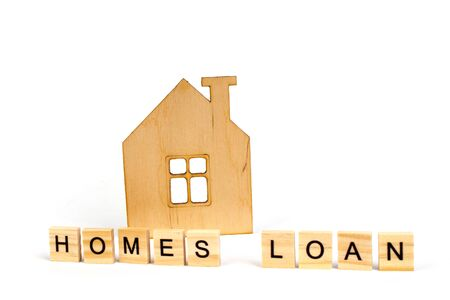 Home loans- word composed fromwooden blocks letters on White background, wooden house symbol. copy space for ad text. Banco de Imagens