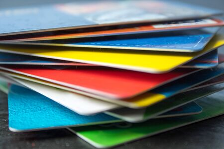 Stack of bank cards on a black background. black friday, sale