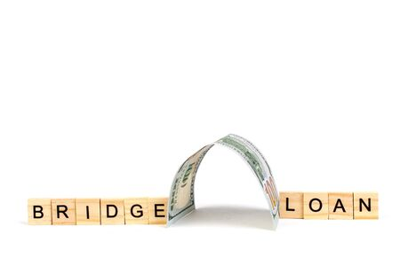 Bridge loans- word composed fromwooden blocks letters on White background, copy space for ad text. Banco de Imagens