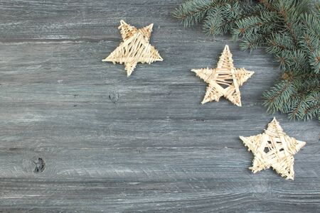 Christmas decoration wooden star with Merry Christmas sign isolated on wooden background