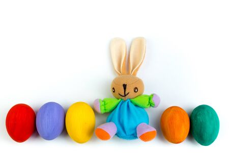 Happy Easter. Colorful easter eggs and rabbit on isolated white background Banco de Imagens