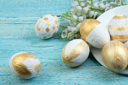 Happy Easter. eggs isolated on wooden table background.. Balls, wreath woven from the vines. Copy space for text. Top view.