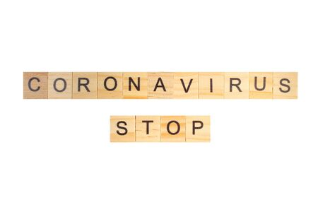 Coronavirus STOP word written on wood block, isolated on white background. top view. Banco de Imagens