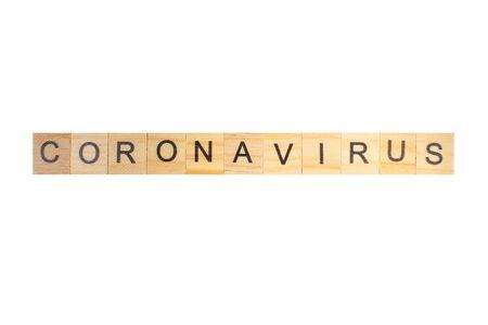 Coronavirus word written on wood block, isolated on white background. top view. Banco de Imagens - 140907544