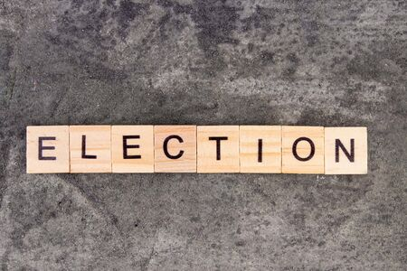 Election word written on wood block, on gray concrete background Banco de Imagens - 139852192