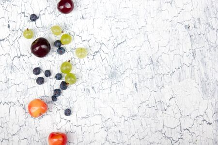 Fresh ripe berry in closeup on Vintage white background. Berries