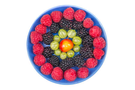 Various summer Fresh berries in a bowl on rustic wooden table. .Antioxidants, detox diet, organic fruits. Top view