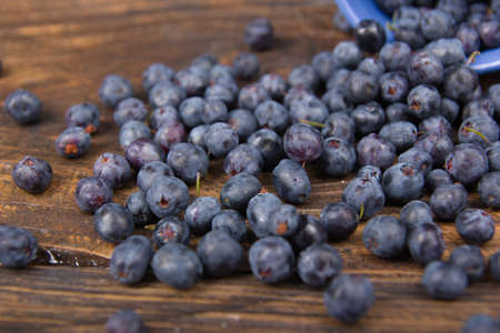 Blueberry on wooden table background, bowl of blueberries. .Antioxidants, detox diet, organic fruits. Berries
