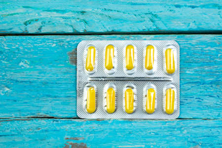 pharmaceuticals pills, tablet and capsules medicine on a wooden table. Banco de Imagens