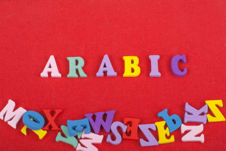 ARABIC word on red background composed from colorful abc alphabet block wooden letters, copy space for ad text. Learning english concept.