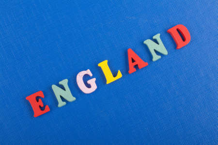 ENGLAND word on blue background composed from colorful abc alphabet block wooden letters, copy space for ad text. Learning english concept.