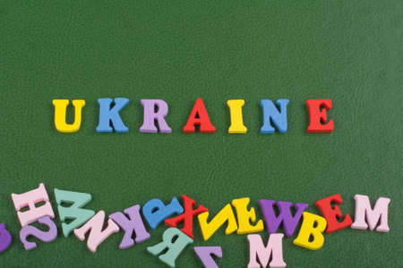 UKRAINIAN word on green background composed from colorful abc alphabet block wooden letters, copy space for ad text. Learning english concept.