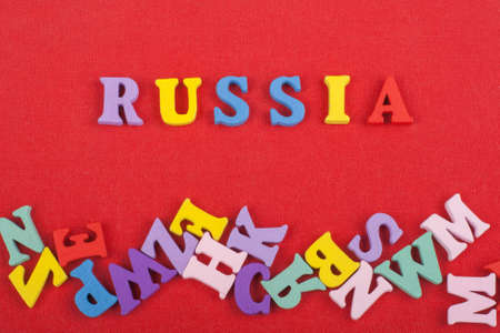 Russia word on red background composed from colorful abc alphabet block wooden letters, copy space for ad text. Learning english concept.